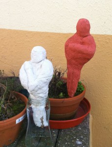 Two sculptures made from air-drying clay. Left outside to weather.
