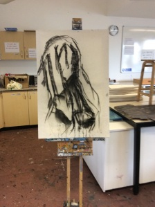 Working into wear canvas with charcoal